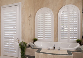 Arched plantation shutters bathroom