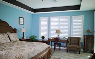 Custom shutters in a bedroom