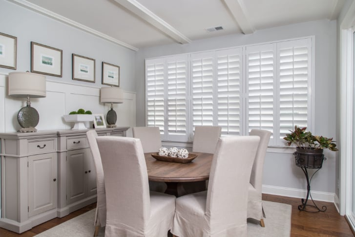 Dining room with white plantation shutters