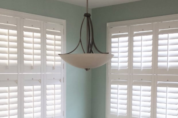 Double hung plantation shutters