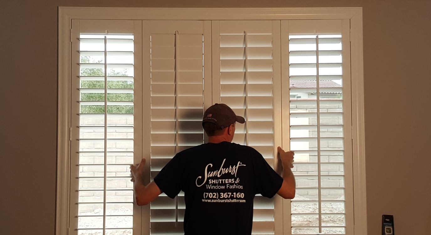 Plantation shutters being installed in a home