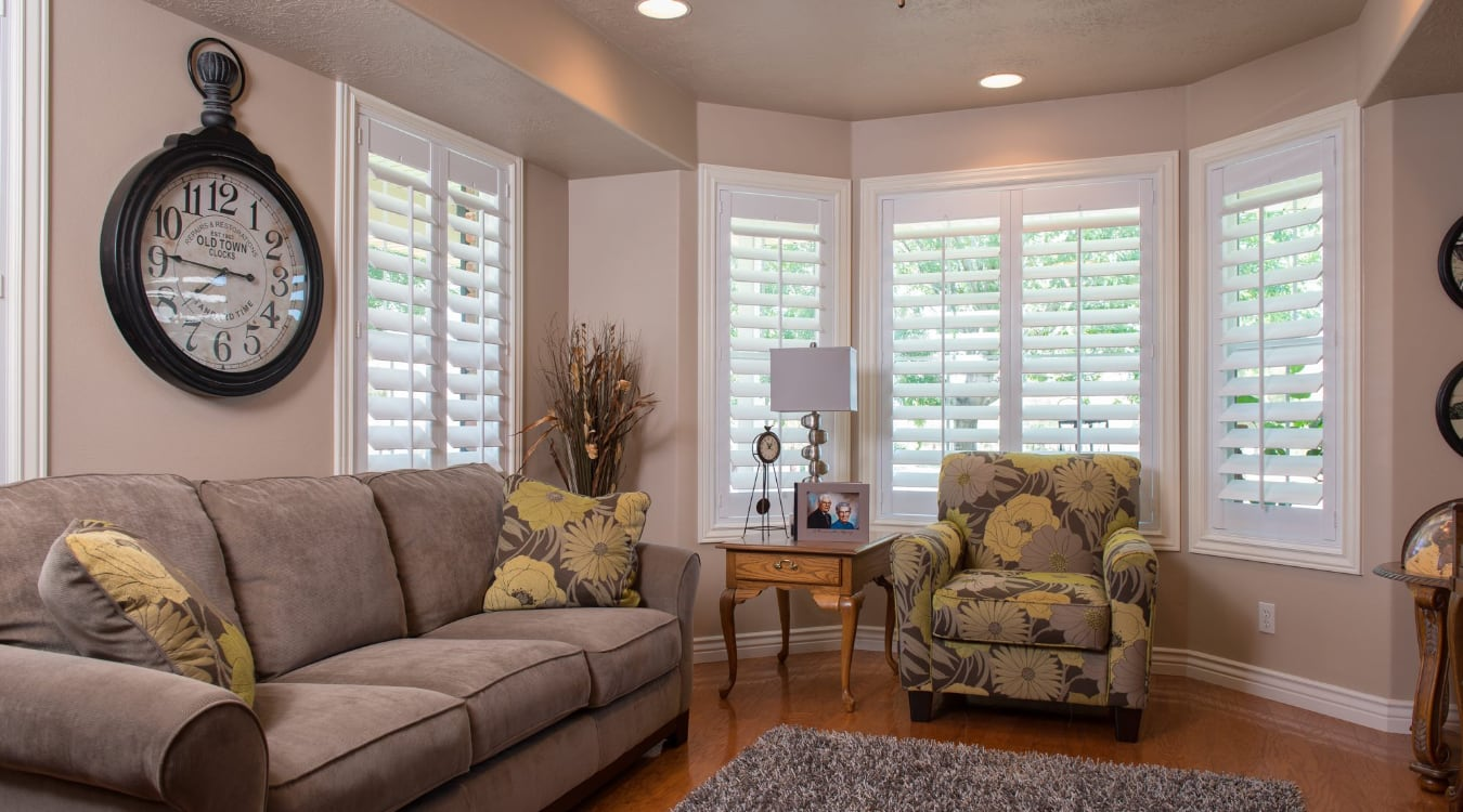 Polywood shutters covering a large window.