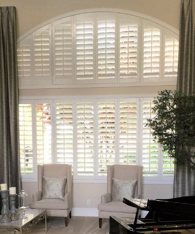 Plantation shutters on an arched window