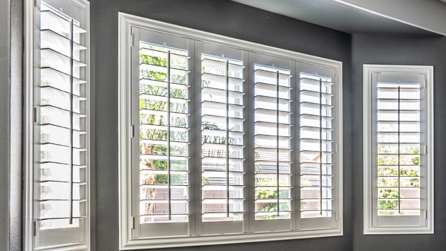 Plantation shutters on bow windows