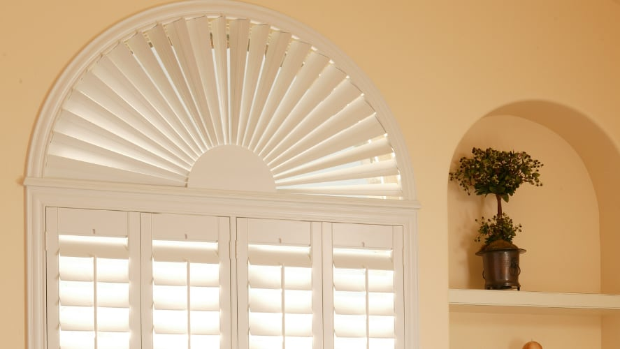 Casement window with white window shades